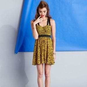 Material Girl Strappy Mustard Black Graphic Dress